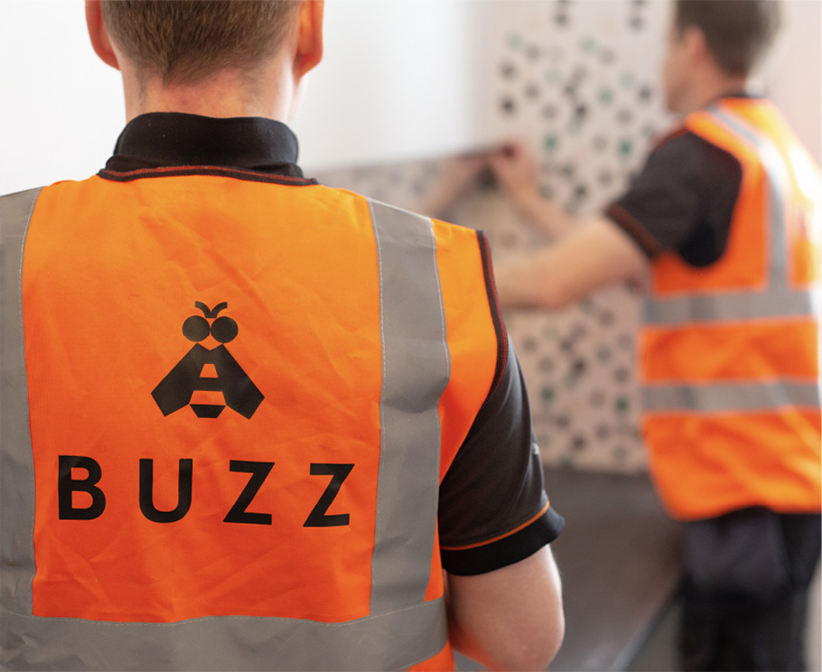 Buzz home office employees fitting Buzz home office furniture at a customer's home